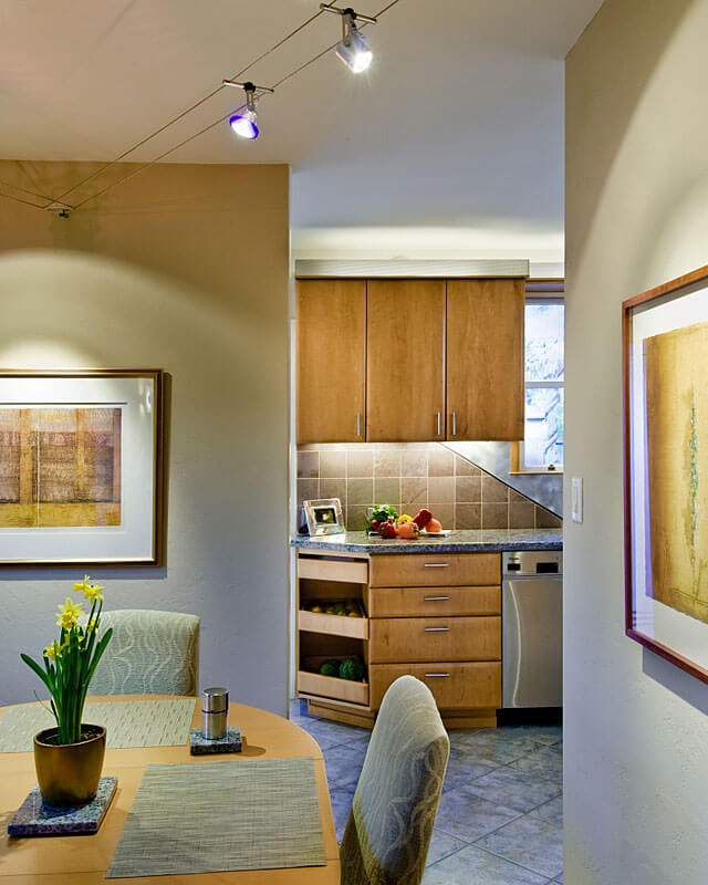 InterSpace Design - View of Remodeled Kitchen from Dining Room lit by Low Voltage Cable Lighting