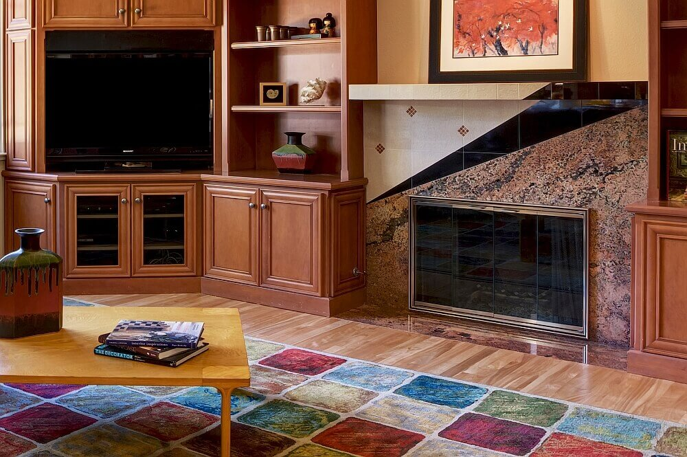 Saratoga family room remodel with a custom fireplace mantle of stone and tiles.