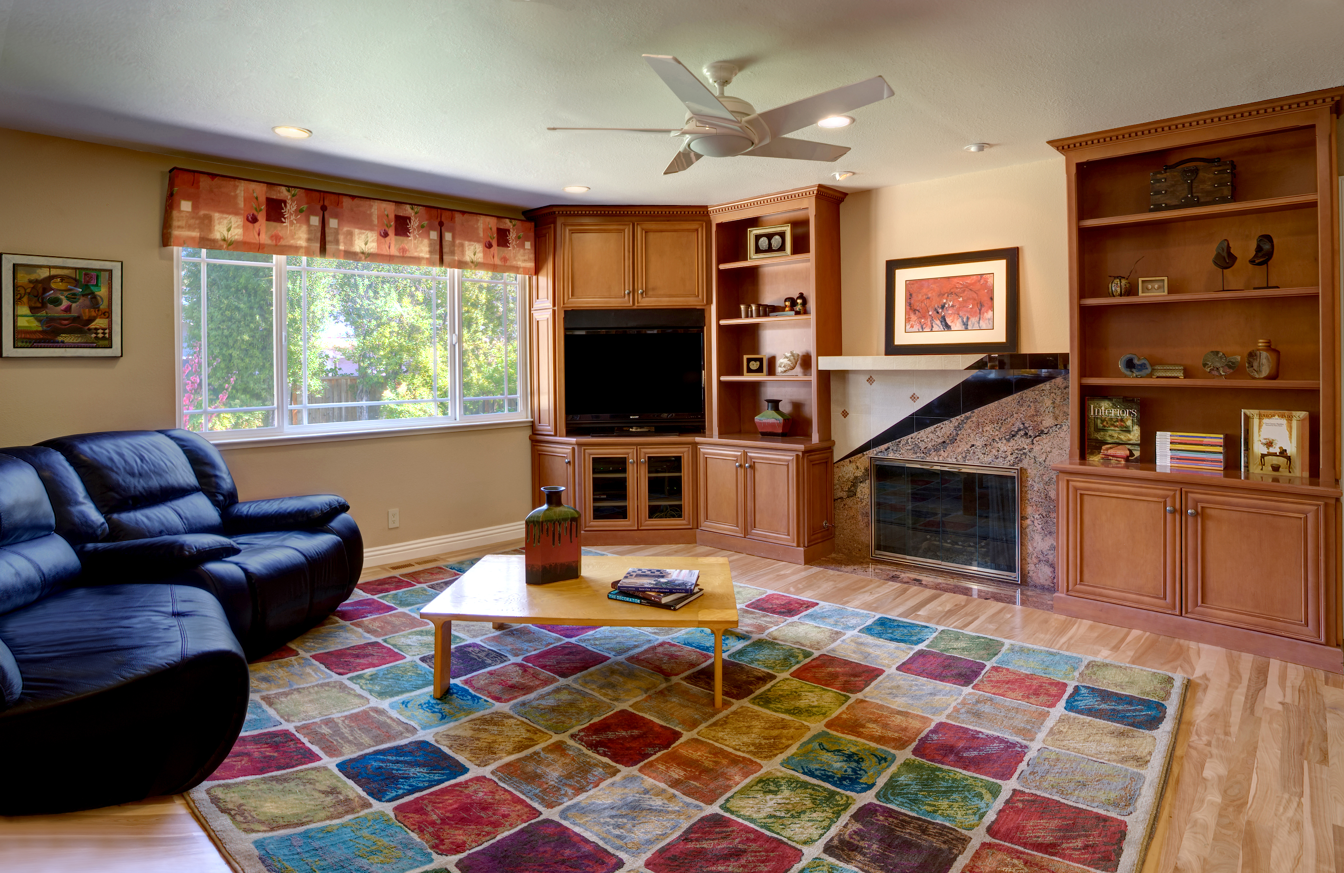 Remodeled Saratoga family room with new cabinetry, fireplace mantle, drapery and flooring