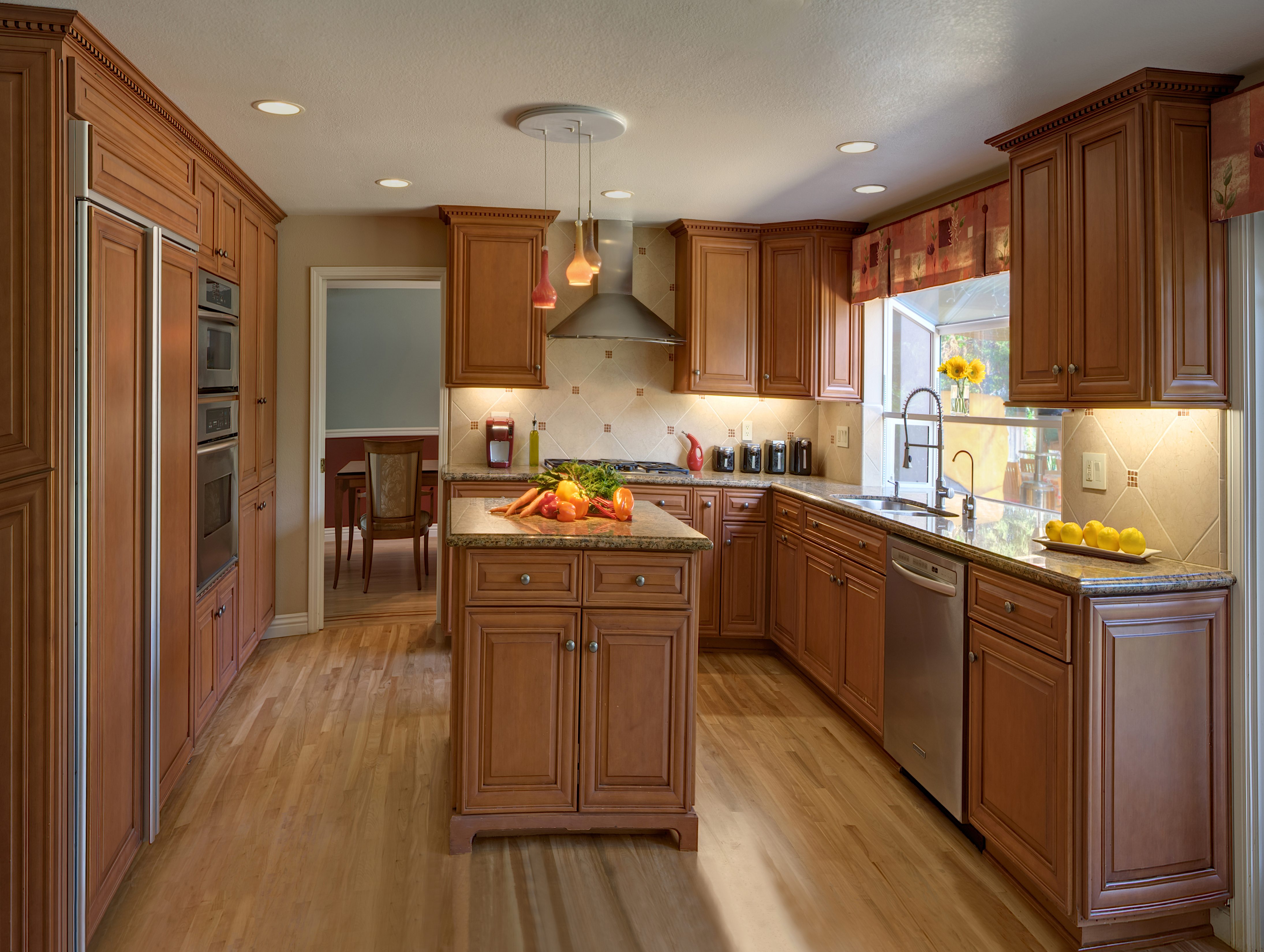 Saratoga kitchen is redesigned with new custom cabinets, counters, lighting, flooring and window coverings.